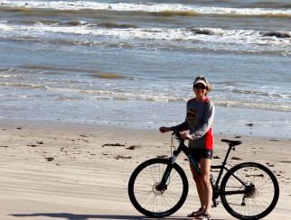 lynn-riding-bike-on-beach-2