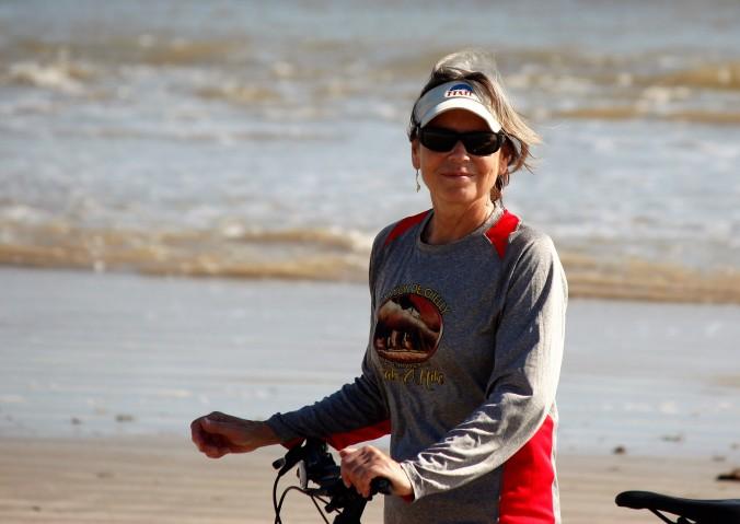 lynn-riding-bike-on-beach-3
