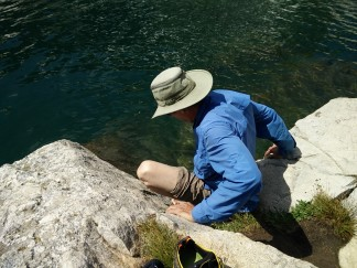 Jim testing the water temperature of Lake Solitude - um, pretty darn cold!
