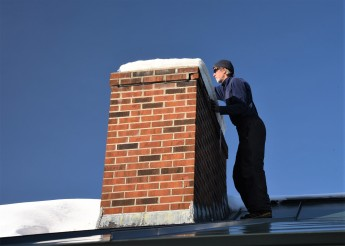 jim on roof chimney maintenance