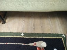 Fastening down the flooring under the sofa...