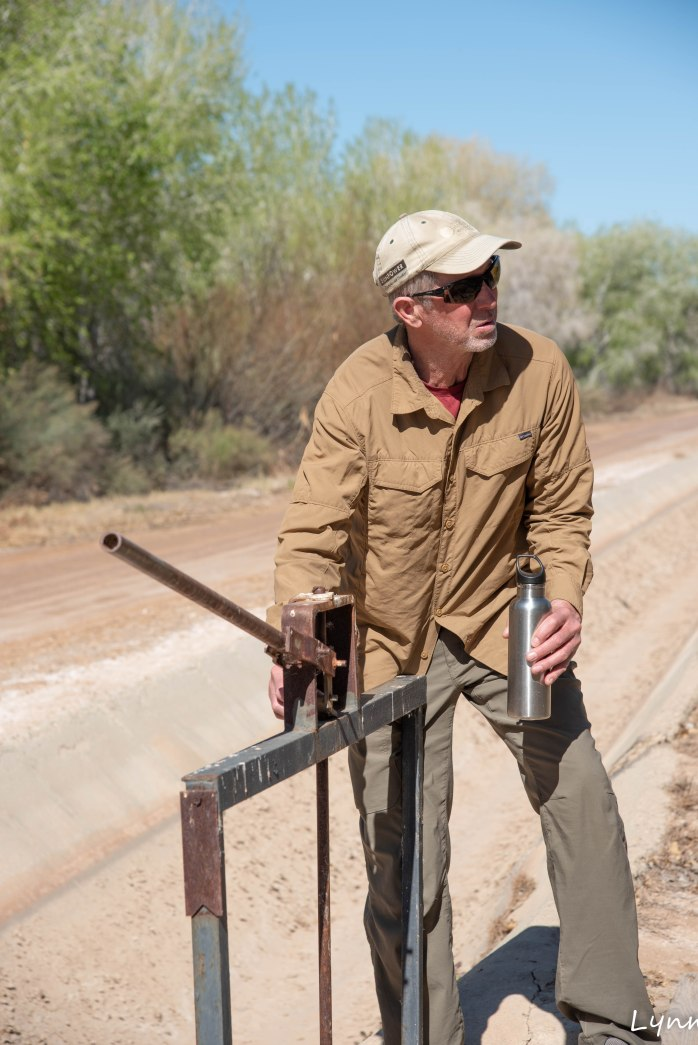 Cibola National Wildlife Refuge Jim investigating a water channel gate